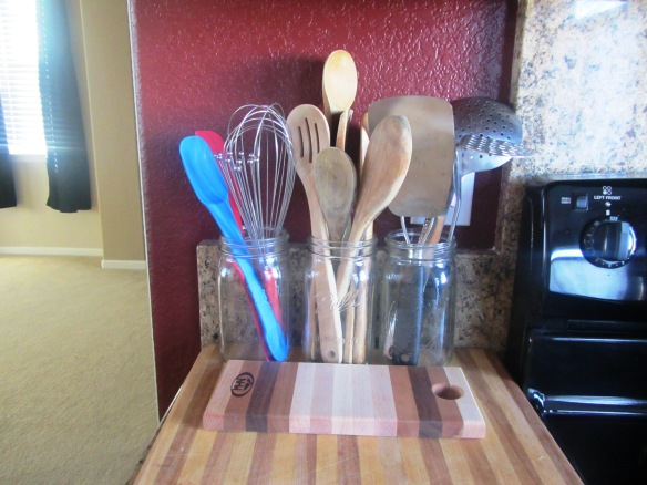 Another mason jar project.  I placed my most used cooking & baking utensils in jars within easy reach of the oven.