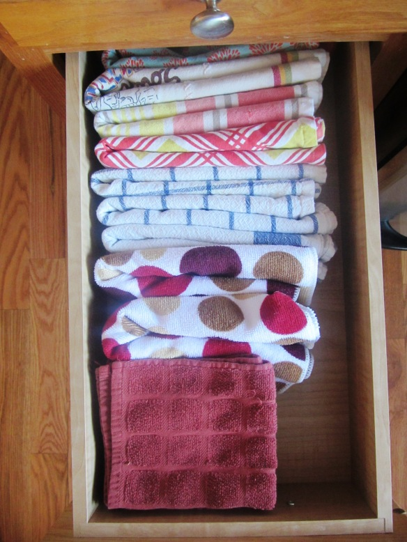 Hand towels and wash clothes are now easily visible and, gasp, I can actually shut the drawer now!