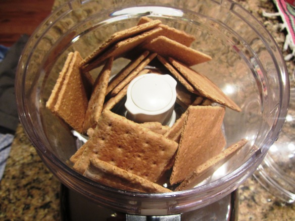 Place graham crackers in your food processor.