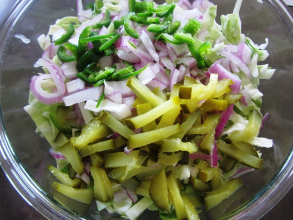 Add cabbage, red onion, pickles, and pickle juice to a large bowl.