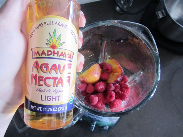 Add peaches, raspberries, and agave nectar to a blender.  I found the agave nectar in the baking aisle.