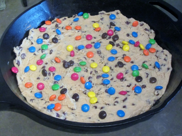 Spread the cookie dough in the pan and sprinkle with M&M's.