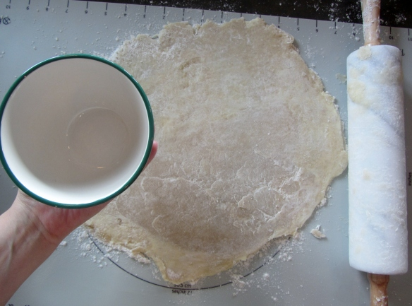 Roll out the dough and find a circular object, about 4 inches in diameter, in your kitchen.  I went with a bowl.