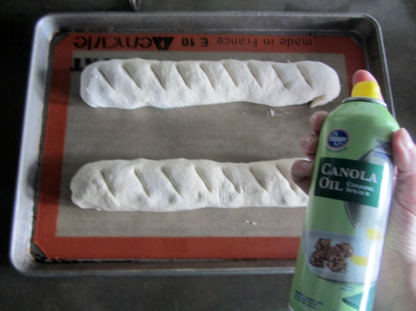 Use a sharp knife to make slits in the dough and then spray on some cooking spray.