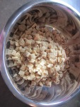 Measure 9 cups of Chex cereal into a large bowl.