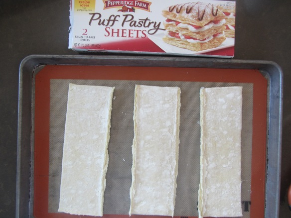 Divide a puff pastry sheet in half or thirds.