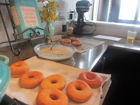 Remove the doughnuts from the oil and set on a paper towel-lined cookie sheet.  Have the glaze ready to dunk the doughnuts.