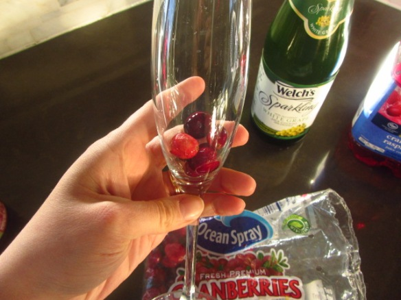 Add a few cranberries to the bottom of the glass.