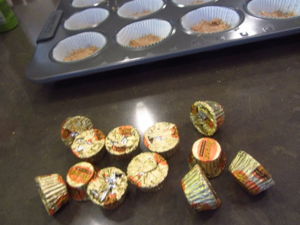 Unwrap your Reese's.  Try to resist them.  Place one in each muffin cup.