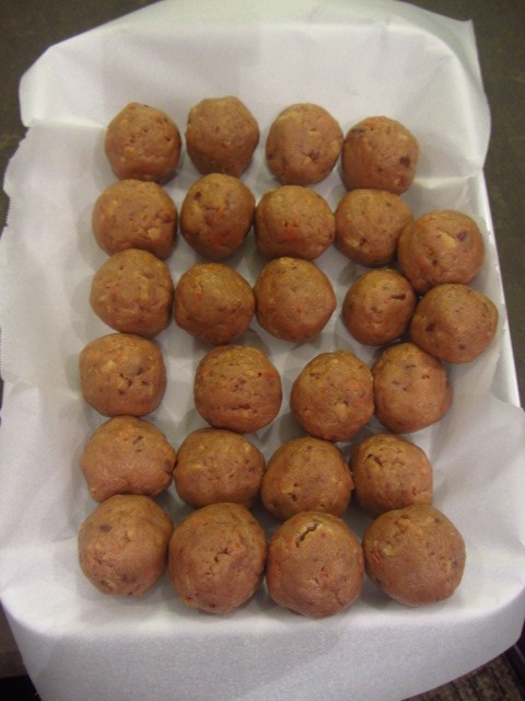 Use a cookie scoop to form balls.  Place on a parchment paper lined pan and freeze for at least 30 minutes.