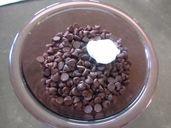 Add the chocolate chips and shortening to a bowl.