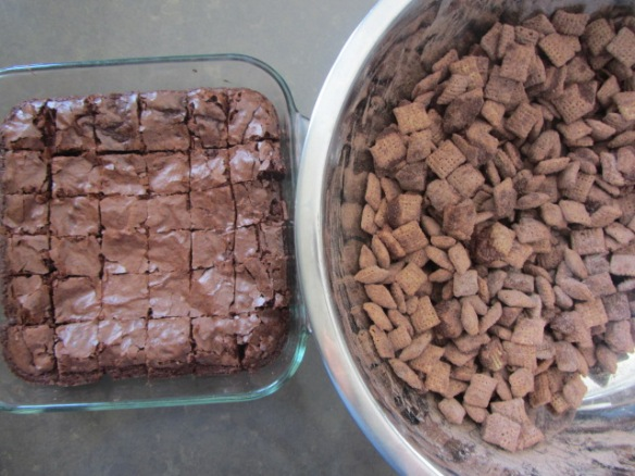 Cut the brownies into bite-sized pieces and mix into the puppy chow.