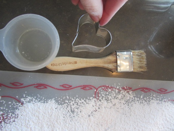 Brush a knife or cookie cutter with oil.
