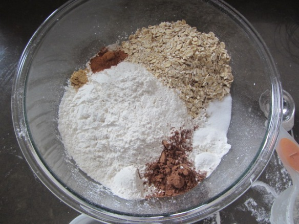 Add the flour, oats, cocoa powder, cornstarch, baking powder, baking soda, salt, cinnamon, nutmeg, and ginger in a bowl.