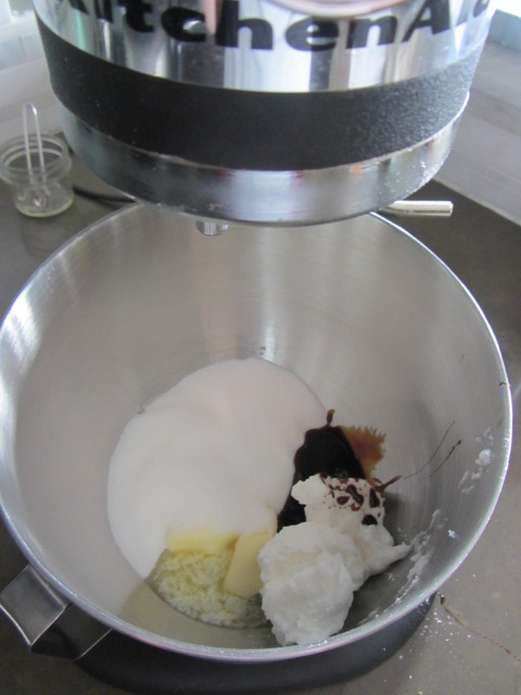 In a mixing bowl, add the butter, shortening, sugar, and molasses.