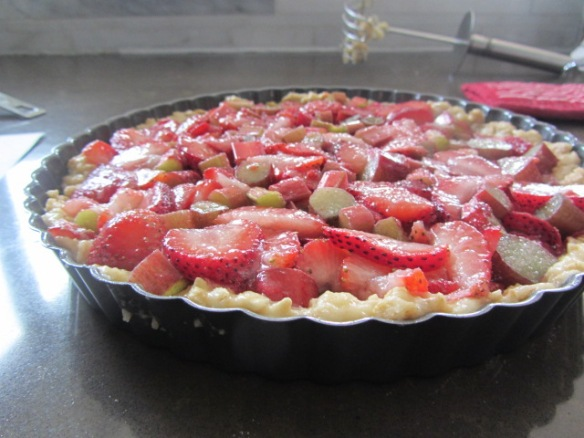 Spread the fruit evenly over the crust.