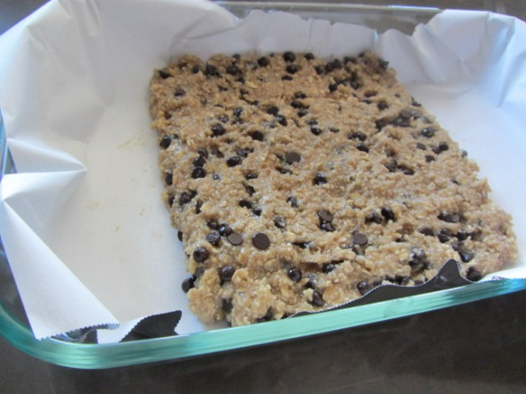 Press into a parchment lined baking sheet or pan.