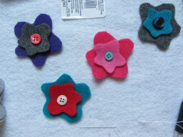 Pick out buttons to go with each felt flower.