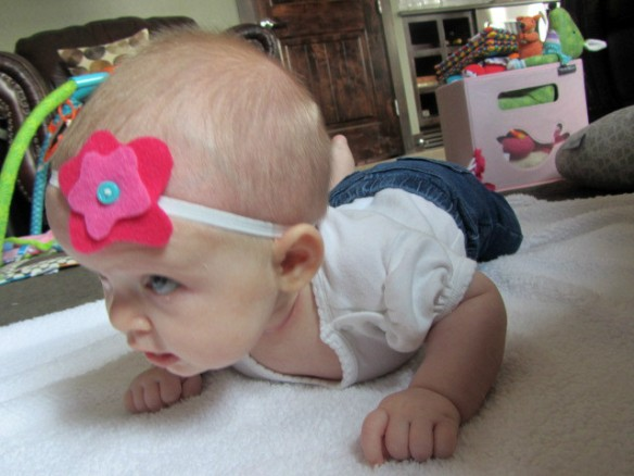 Place headband on baby and admire :)