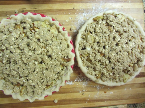 Split the topping between the two pies.  Press down the topping slightly, to ensure that it sticks to your filling but without crushing it.