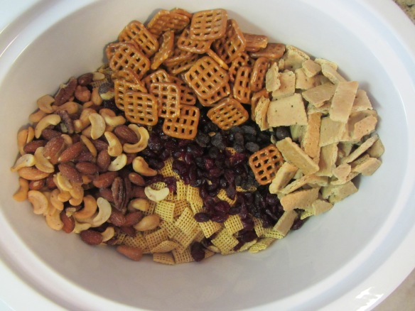 Add cereal, dried fruit, nuts, pretzels, and graham crackers to your Crock-Pot.