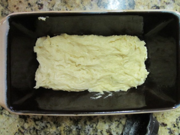 Pour half of the batter into a greased loaf pan.