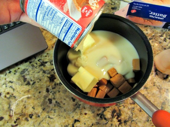 Combine the unwrapped caramels, butter, and sweetened condensed milk in a small saucepan.