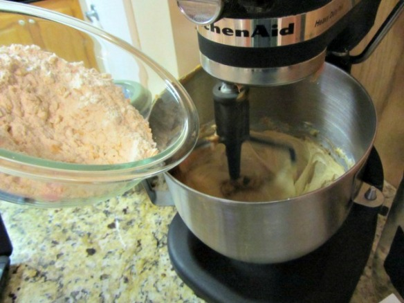 Pour the flour mix into the sugar mix and combine.