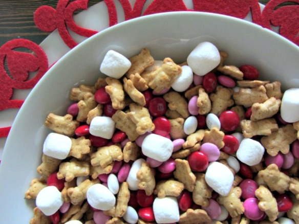 All you need for this treat are marshmallows, Teddy Grahams, and Valentine M&Ms.  Oh, and a bowl to mix them in :)