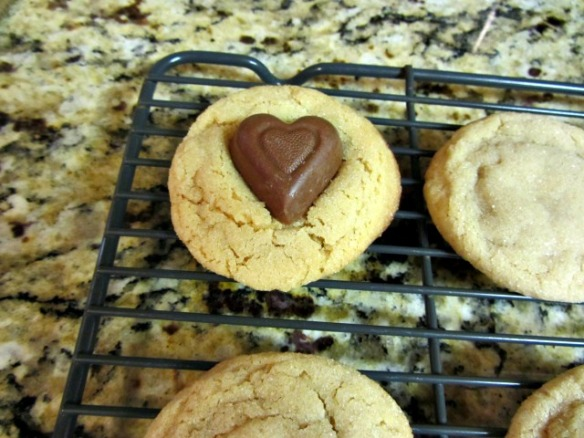 Transfer to a wire cooling rack and press a Reese's Heart into the middle of each cookie.