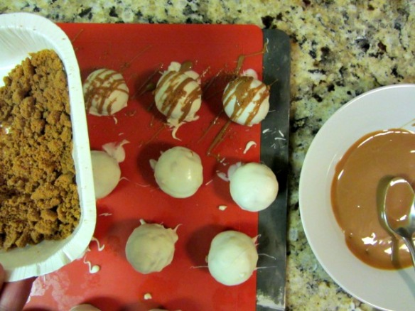 Drizzle the melted Cookie Butter over the cake balls.  Sprinkle with crumbled Biscoff cookie crumbs.
