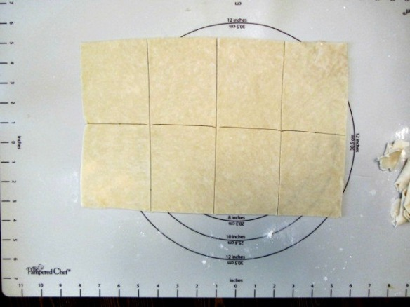 Cut down to a 12x10-inch rectangle to straighten out the edges.  Cut into 8 equal (ish) rectangles.