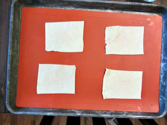 Place 4 of the rectangles on a nonstick baking sheet.