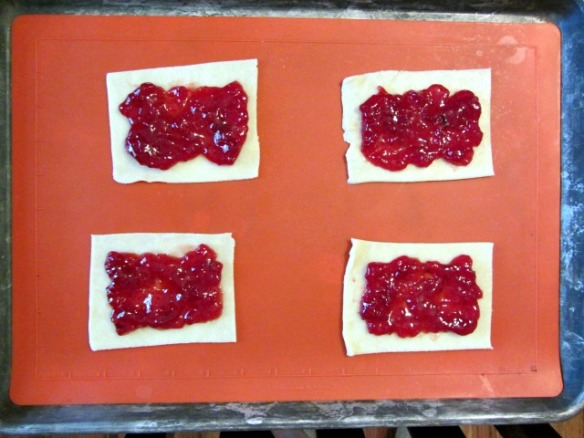 Spread preserves over the center of each, leaving just 3/4-inches plain around the edges.