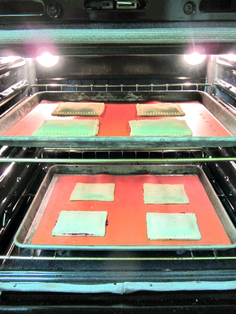 Place frozen tarts in a 375 degree oven with the oven racks in the top & bottom third of the oven.