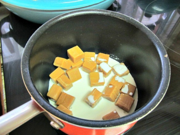 Prepare the caramel layer.  Add caramels and heavy cream in a small saucepan.  Heat over medium-high heat, stirring constantly until the caramel is smooth.