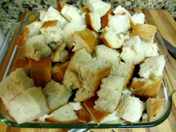 Top with remaining bread cubes.