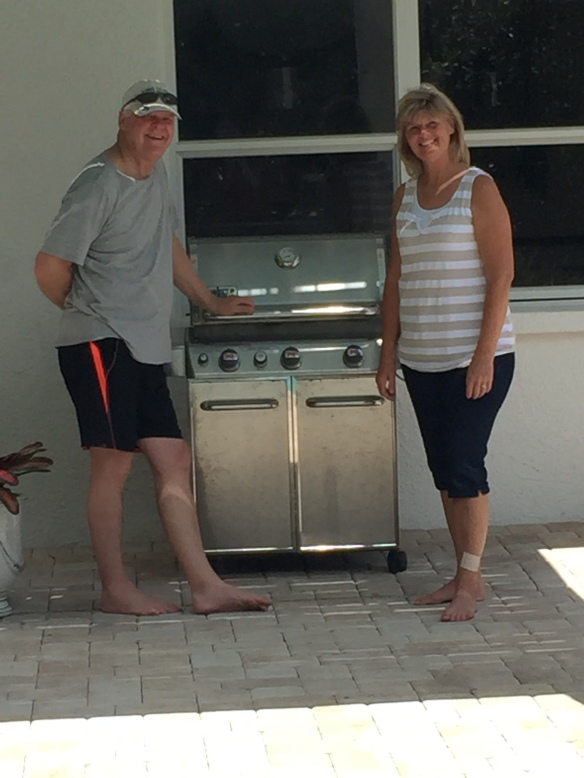 Dad & Aunt Theresa grilling.