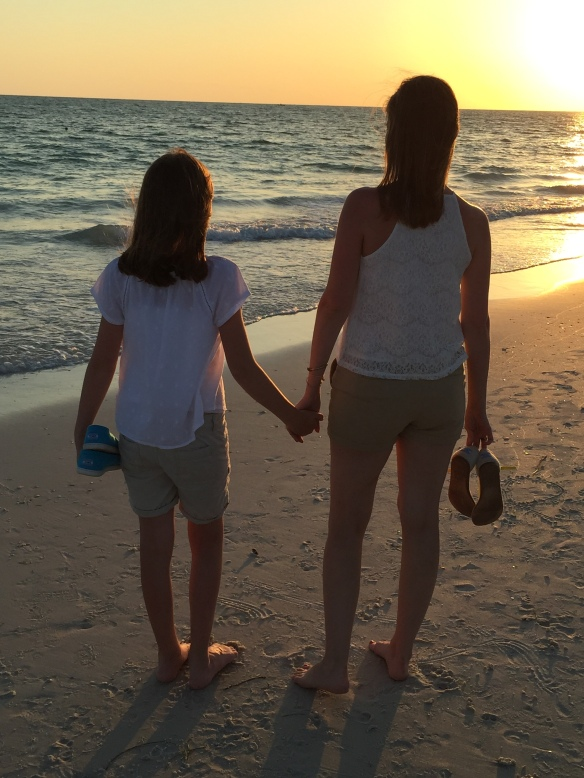 Watching the sunset, holding their Toms.