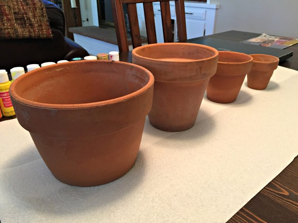 Clean flower pots, ready to be painted.