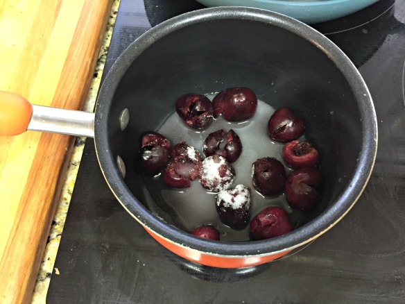 Place cherries, sugar, & water in saucepan.  Bring to a boil and then reduce heat and simmer until sauce forms and thickens.