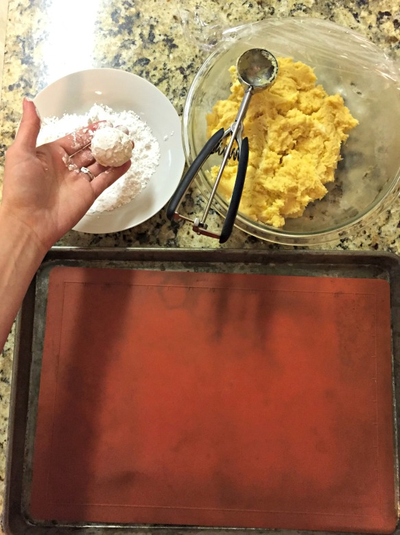 Scoop out 1-inch balls and coat with confectioners' sugar.  Place on cookie sheet, at least 1-inch apart.