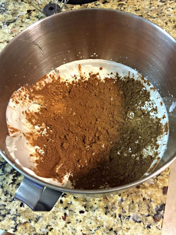 Sift in the powdered sugar and cocoa powder.