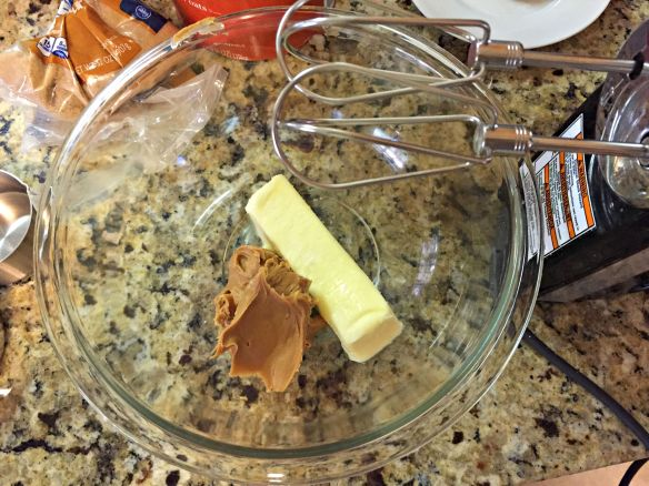 Cream together butter and peanut butter, about 1 minute.