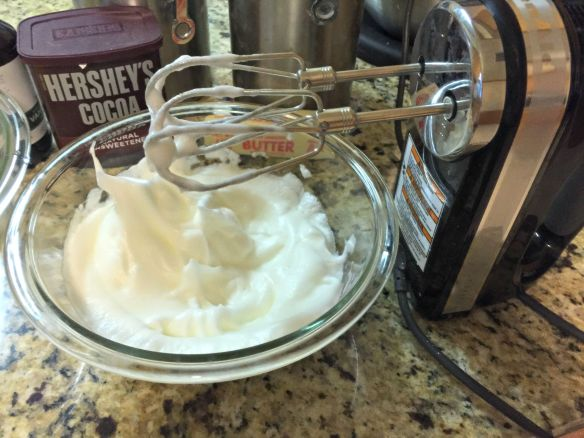 Use a hand mixer on the egg whites, beating until stiff peaks form.