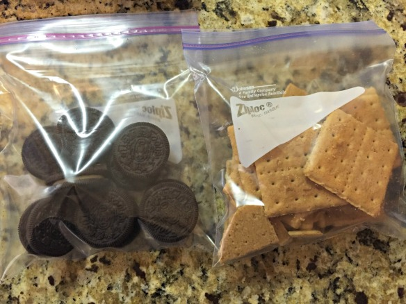 Place graham crackers in one bag and Oreos in another bag.