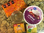 Everything you need: Orange Jello, Yellow Jello, Whipped Cream, Candy Corn, & clear cups.