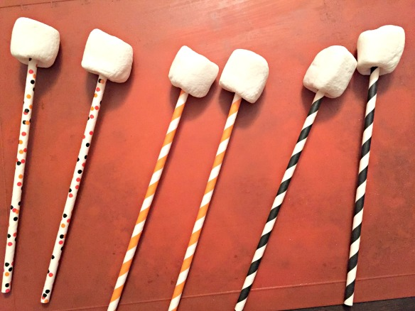 Stick those marshmallows on the straws.