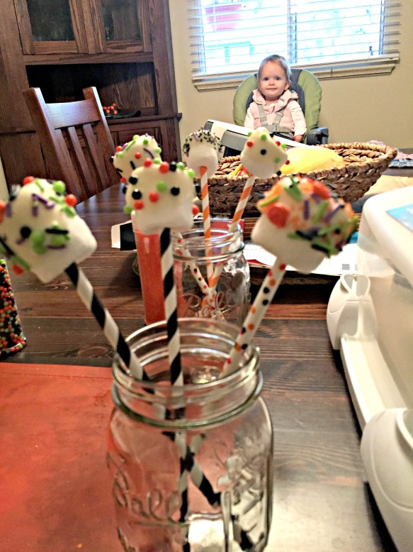 "Allow chocolate to set up by setting up the sticks in cups. Quinn could only look on in wonder. When the sprinkles spilled, she said ""Oh, Mom"" in the saddest/judgiest voice ever. It made a messy situation hilarious."