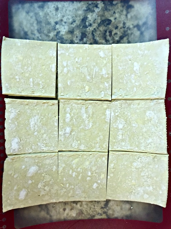 Cut sheet of puff pastry into 9 squares.